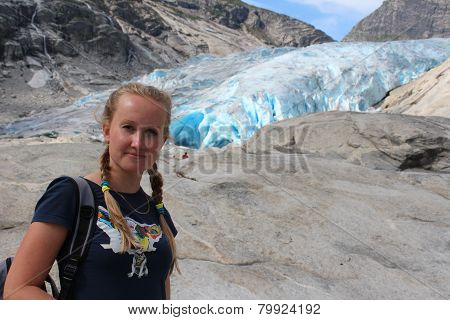 Young woman on the Nigardsbreen. Travel Norway.