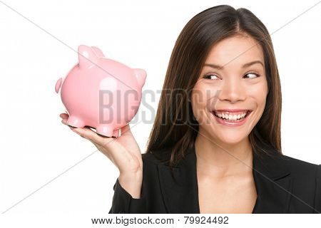 Piggy bank savings woman smiling happy. Female business woman holding pink piggy bank isolated on white background. Multi-ethnic Chinese Asian / Caucasian girl.