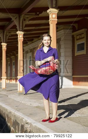 Woman In Lilac Dress With Reddish Scarf