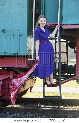 Woman At Lilac Dress On Train Stairs