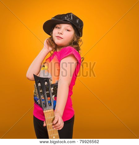 Small child hold acoustic guitar