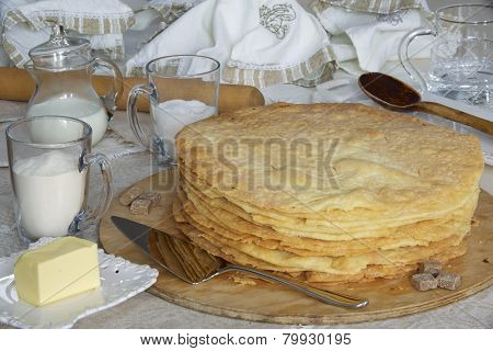 Freshly baked shortcakes for Napoleon cake and some ingredients.
