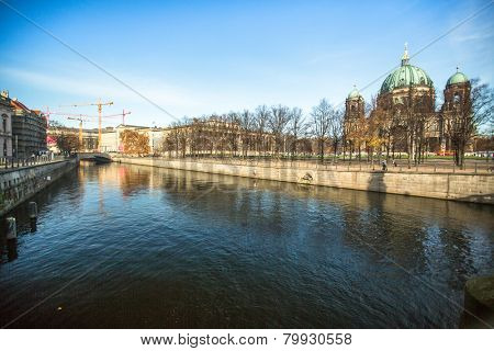 BERLIN, GERMANY - NOV 17, 2014: Spree river and Berlin Cathedral  (Berliner Dom) is the largest Evangelical Church in Germany. Cathedral was built in 1894-1905 by project Julius Raschdorff.