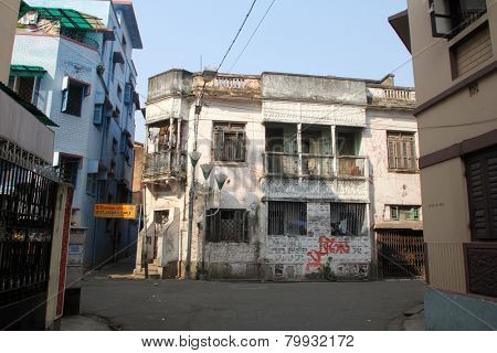 KOLKATA, INDIA - NOVEMBER 25: An aging, decaying, ex-colonial tenement block in Kolkata, West Bengal, India on November 25, 2012.