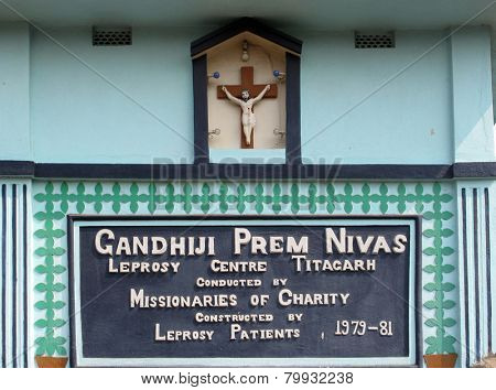 TITAGARH, INDIA - FEBRUARY 02, 2009: The inscription at the entrance to Gandhiji Prem Nivas( Leprosy center), established by Mother Teresa and run by the Missionaries of Charity in Titagarh, India