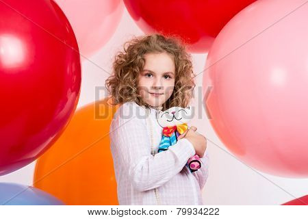 Beautiful Teen Girl With A Soft Toy In Hand Over Large Rubber Balloons