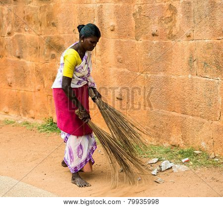 Thanjavur, India - February 14: An Unidentified Indian Woman In National Dress Carries Sweeping The
