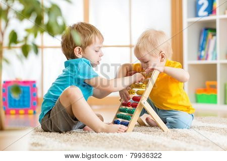 kids boys playing with abacus