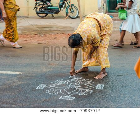 Thanjavour, India - February 14: An Unidentified Woman Paints Ornaments Rice Flour On The Asphalt Ro