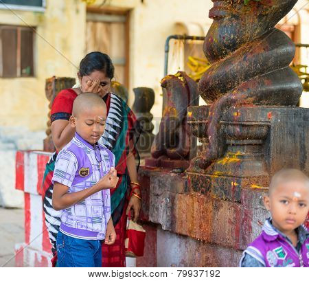 Madurai, India - February 16: An Unidentified Boy And Woman Commit Ritual Actions. India, Tamil Nadu