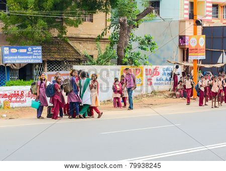 Madurai, India - February 15: An Unidentified Girls And Boys In School Uniform Are Standing At The R