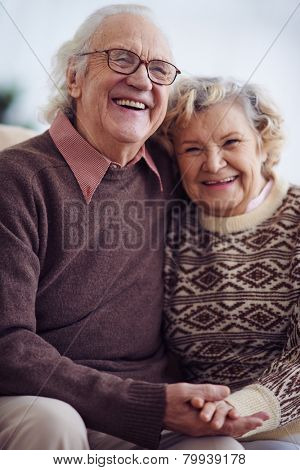 Ecstatic seniors in sweaters laughing