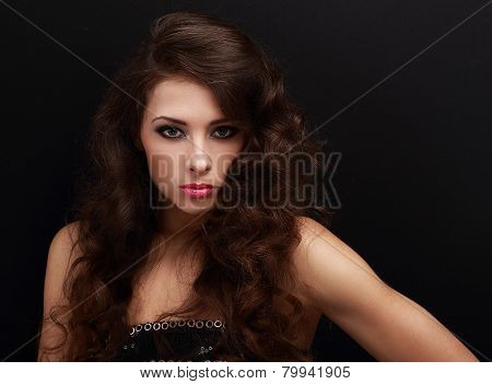 Beautiful Sexy Female Model With Long Curly Hair Looking Vamp On Black