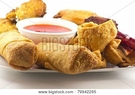 Pu pu platter with crab rangoon egg rolls fried chicken BBQ Beef sticks and fried wontons with sweet sauce