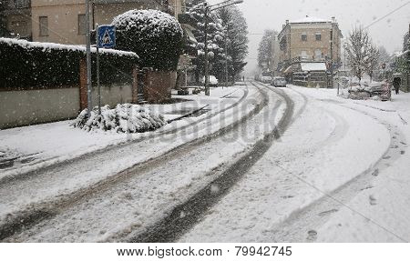 City Street With White Snow During A Winter Snowfall