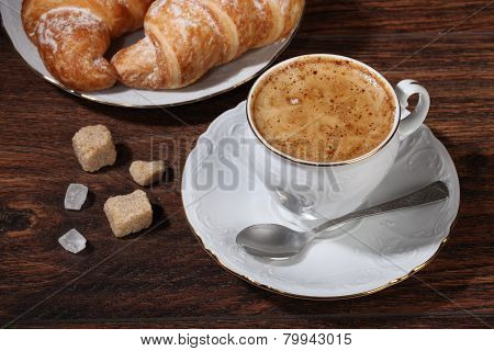 Coffee In A White Cup And A Croissant