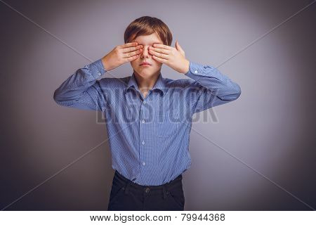 teenager boy of 10 years European appearance closed eyes with