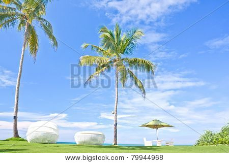 Beach Umbrella And Sunbath Seats In A Tropical Hotel That Located In Costal Area Negambo, Sri Lanka