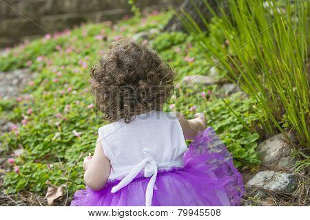 Backside Of Little Girl In The Garden