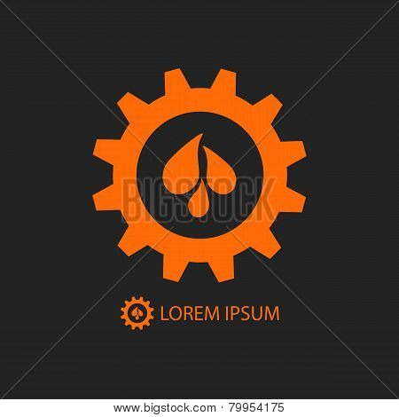 Black and orange gear wheel with water drops