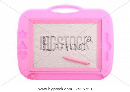 Pink magnetic drawing board with Einstein's equation isolated on white