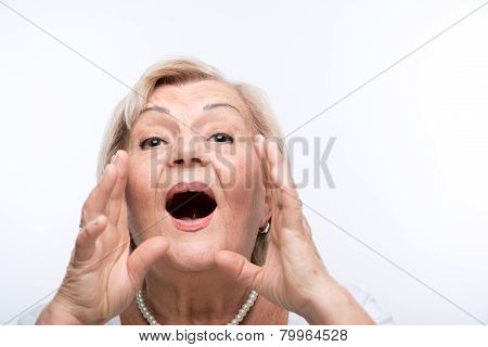 Closeup of elderly woman shouting