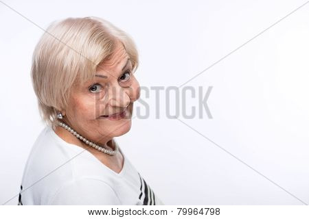 Closeup of elderly woman looking from behind