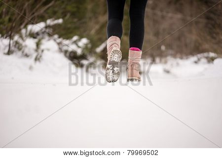 Person Walking Through Snow Wearing Boots