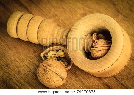 Walnuts And Nutcracker On Rustic Wooden Table