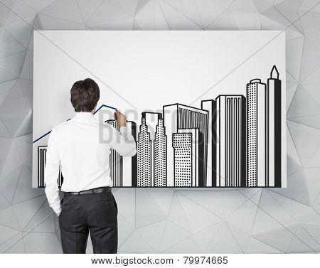 Businessman Drawing Buildings