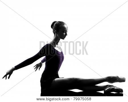 one  young woman ballerina ballet dancer stretching warming up in silhouette studio on white background