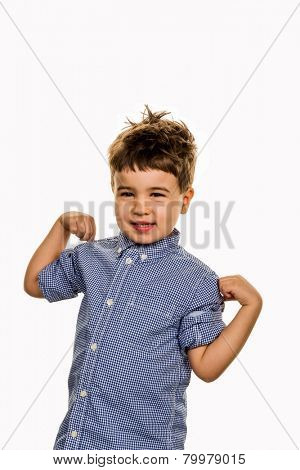 little boy in pose, a symbol of self-esteem, childhood, lightheartedness, cleverness