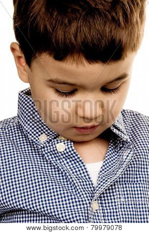 portrait of a little boy, a symbol of childhood, insecurity, shyness