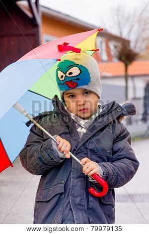child with umbrella, symbol of childhood, solidarity, help, aid package, bailout,