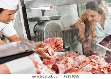 Mature woman buying fresh meat at butchery