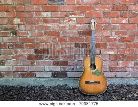 Musician Takes A Break - Guitar & Red Brick Wall.