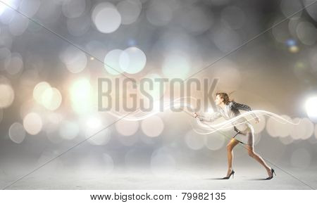 Young pretty businesswoman running in a hurry