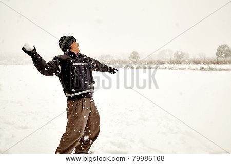 Young man throwing a snowball