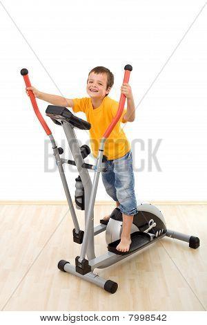 Boy On Elliptical Trainer