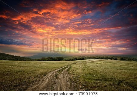 sunet over dirt road