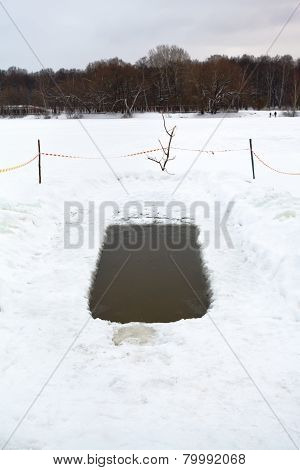 Ice Hole With Frozen Water In River