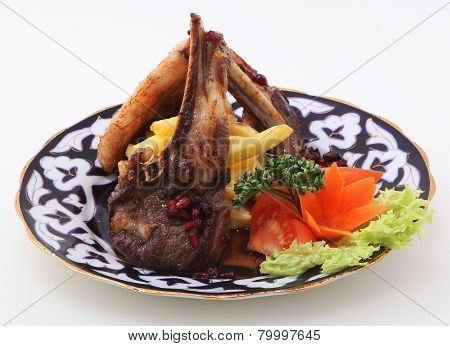 Steak Prepared On A Grill Submitted With A Potato And Vegetables