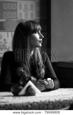 Black And White Portrait Young Woman In Restaurant.