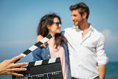 picture of clapper board  - couple of actors on the movie set - JPG