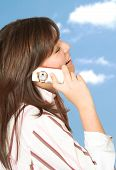 casual girl on the phone outdoors poster