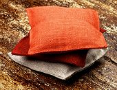 picture of sachets  - Stack of Three Textile Sachet Pillows closeup on Textured Wooden background - JPG