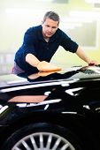 picture of luxury cars  - Man worker polishing car on a car wash  - JPG