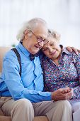 stock photo of amor  - Amorous couple of pensioners in smart clothes - JPG