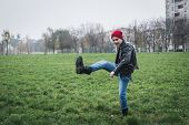 pic of anarchists  - Punk guy with beanie posing in a city park - JPG