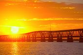 picture of florida-orange  - Beautiful colorful sunset or sunrise with railway bridge - JPG